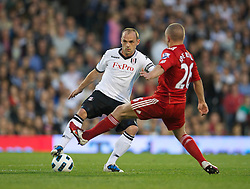 LONDON, ENGLAND - Monday, May 9, 2011: Liverpool's Jay Spearing and Fulham's Danny Murphy during the Premiership match at Craven Cottage. (Photo by David Rawcliffe/Propaganda)