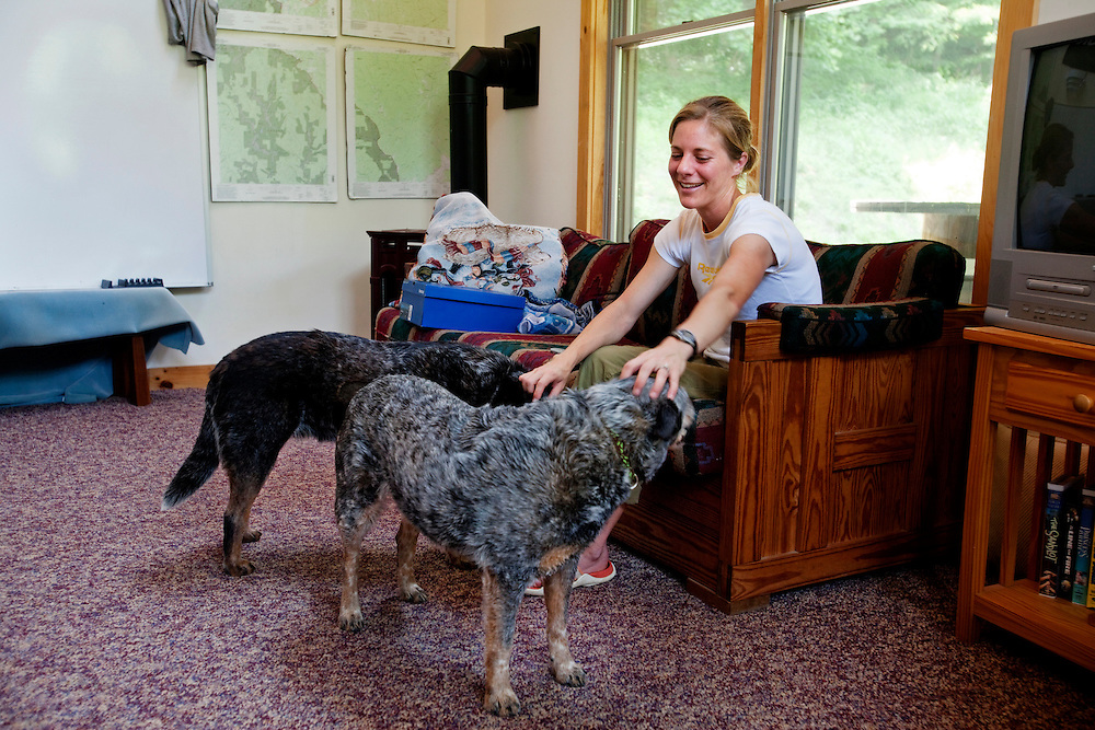 Zap Fitness founder Zika Rea plays with her dogs Angel and at the training facility in Blowing Rock, NC..