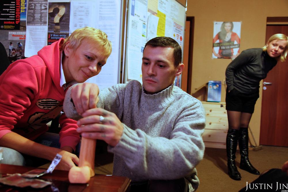 Irina Maslova (LEFT), HIV activist, demonstrates correct condom use.