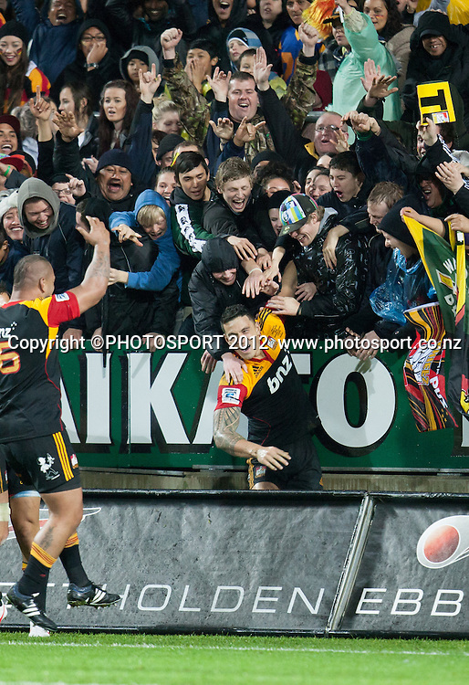 Chiefs' Sonny Bill Williams jumps into the crowd after scoring a try during the Investec Super Rugby final between Chiefs and Sharks won by Chiefs 37-6 at Waikato Stadium, Hamilton, New Zealand, Saturday 4 August 2012. Photo: Stephen Barker/Photosport.co.nz