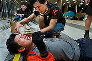 Students victim of pepper spay in the face being treated by a fellow protestor<br /> <br /> 17th day of pro-democracy protest in Hong Kong