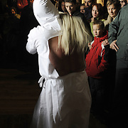 """A penitent (called """"Picao"""") whips himself during the procession of the fellowship of Santa Vera Cruz this Holy Friday in San Vicente de la Sonsierra (330km north of Madrid, in La Rioja), on April 10, 2009. This traditional procession takes its origin in the XVI century."""