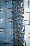 Israeli flags on a building in Tel Aviv. the flags were strung up for Independence Day celebrations