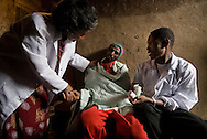 Sister Yewagenesh working with her health outreach workers in the Woreda district slums of Addis Abba, Ethiopia.  She works for HIWOT, a nonprofit founded by another nurse,Sister Tibebe.