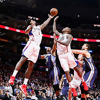 09 November 2015: Los Angeles Clippers center DeAndre Jordan (6) vies for the rebound with Memphis Grizzlies guard Mike Conley (11) and Los Angeles Clippers guard Jamal Crawford (11) during the Los Angeles Clippers 94-92 victory over the Memphis Grizzlies, at the Staples Center, in Los Angeles, California, USA.