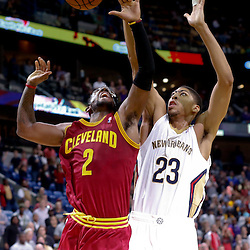 Nov 22, 2013; New Orleans, LA, USA; New Orleans Pelicans power forward Anthony Davis (23) blocks a shot by Cleveland Cavaliers point guard Kyrie Irving (2) during the fourth quarter of a game at New Orleans Arena. The Pelicans defeated the Cavaliers 104-100. Mandatory Credit: Derick E. Hingle-USA TODAY Sports