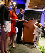 Mayor Walt Maddox gives his acceptance speech at the Hotel Indigo Tuesday, March 7, 2017 while his son Eli reaches for microphone. At left are Maddox's daughter Taylor and his wife Stephanie.  [Staff Photo/Gary Cosby Jr.]