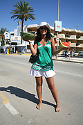 A girl holding slices of watermelon, Bora Bora Beach, Ibiza, 2006