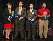 L-R: Houston Astros Senior Vice President for Community Relations Meg Vaillancourt, Houston Food Bank President & CEO Brian Greene, IPAA President & CEO Barry Russell and Target Group Vice-President for South Texas Dell McKinney stand with there group's Hall of Fame trophies during the Houston ISD Partnership Appreciation breakfast at Kingdom Builders, October 25, 2013.