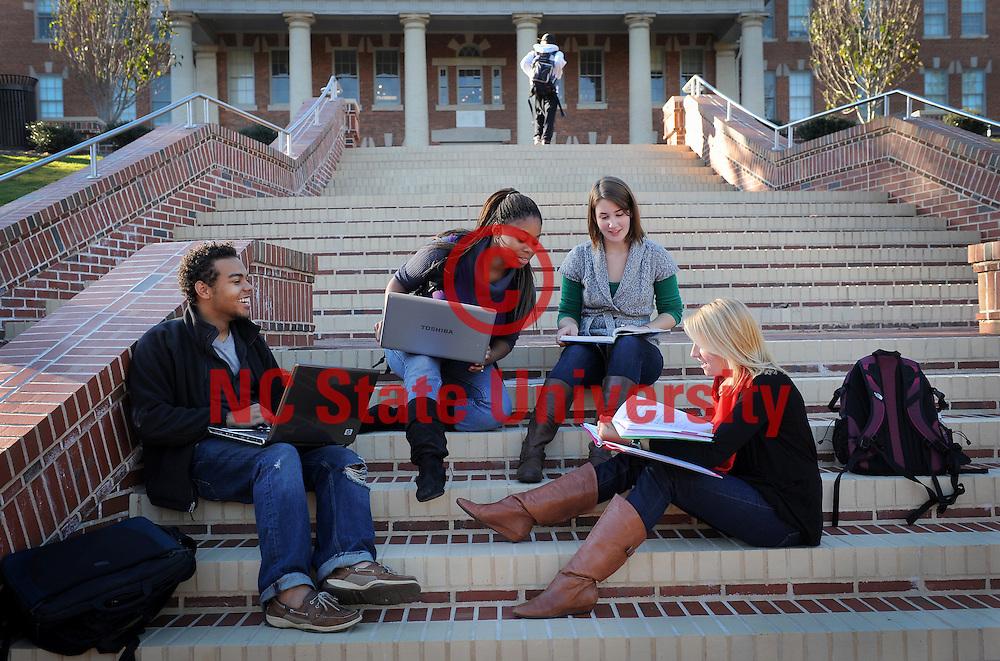 NCSU students enjoy a break from class near the 1911 Building. Photo by Becky Kirkland