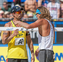 04.08.2013, Klagenfurt, Strandbad, AUT, A1 Beachvolleyball EM 2013, Finale Herren, Spiel 72, im Bild Adrián GAVIRA Collado 2 ESP, Alexandrs Smoilovs 1 LAT <br /> // during Final match 72 of the A1 Beachvolleyball European Championship at the Strandbad Klagenfurt, Austria on 2013/08/04. EXPA Pictures © 2013, EXPA Pictures © 2013, PhotoCredit: EXPA/ Mag. Gert Steinthaler