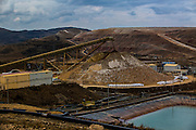 Crushed stones and mined soil of high fineness are piled up aside a mill in order to be processed in Yanacocha gold mine, Peru, Wednesday, October 21, 2015. (Hilaea Media/Dado Galdieri)