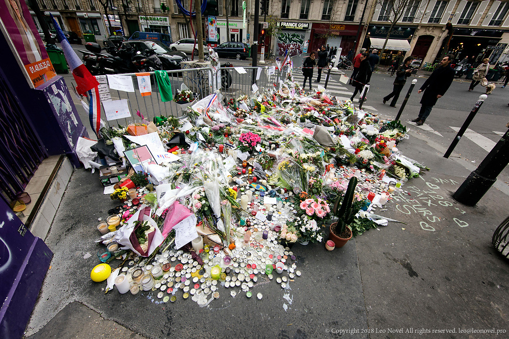 16  November  2015 – Paris, France Mourners lay flowers and light candles next to Bataclan concert venue in central Paris.  In a series of acts of violence, some 129 people were killing in shootings and suicide bombing. ISIL or islamic state claimed the responsibility.