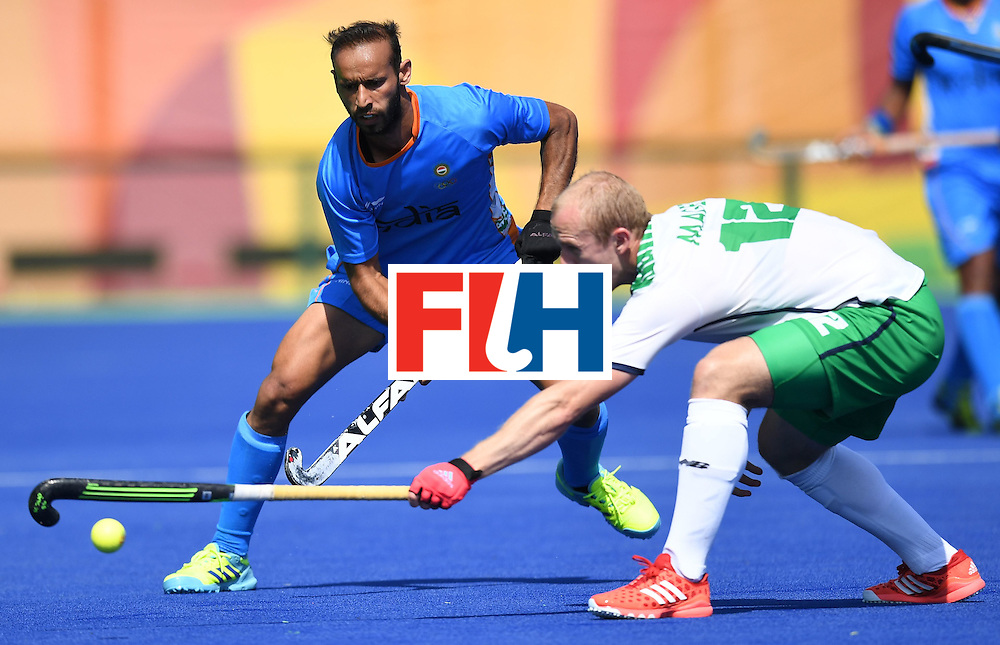 India's Ramandeep Singh (L) fights for the ball with Ireland's Eugene Magee during the men's field hockey India vs Ireland match of the Rio 2016 Olympics Games at the Olympic Hockey Centre in Rio de Janeiro on August, 6 2016. / AFP / MANAN VATSYAYANA        (Photo credit should read MANAN VATSYAYANA/AFP/Getty Images)