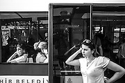 Women using the tram in Istanbul.