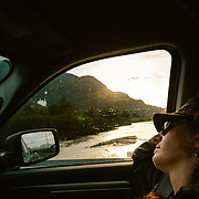 Heather Goodrich rests during the drive back to Seward along the Seward Highway in Alaska.