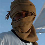 Egypt, Aswan. December/27/2008...Khalid; the smiling eyes of a proud falouka boat captain and Nubian man. Warmth and hospitality abound.