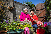 No repro fee<br /> 22-6-2018<br /> **DERMOT BANNON GETS HIS FINGERS GREEN FOR THE BANK OF IRELAND BACKYARD BLITZ**<br /> **450 Bank of Ireland volunteers swap hedge funds for hedge clippers across Dublin, Galway and Cork**<br /> Picture shows Mary Downs, East Wall resident with Celebrity Architect and RT&Eacute; star Dermot Bannon; along with over 450 Bank of Ireland volunteers tackled 200 gardens in Dublin, Cork and Galway today as part of a community initiative with Age Action. Now in its second year, the Bank of Ireland Backyard Blitz matches employees with older members of the community whose gardens are in need of a summer tidy-up and find these jobs hard to tackle by themselves. <br /> One of the gardens that benefited from an expert makeover was the Se&aacute;n O&rsquo;Casey Community Centre Garden in East Wall. The Centre provides a space for members of the 5,000-strong community in the area, 70% of which are aged over 65. With Dermot Bannon&rsquo;s design expertise, Bank of Ireland volunteers will refurbish the garden adding a patio area, pergola, beautiful plants and a mural to brighten up the area for all the residents of the community.  <br /> In addition to the Backyard Blitz, Bank of Ireland supports Age Action with volunteering, fundraising and financial support, as well as providing teaching on the basics of the internet and digital world through Tea &amp; Teach sessions. <br /> Pic:Naoise Culhane-no fee