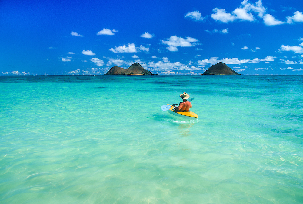 Kayaker and Mokulua Islands, Lanikai Beach, Windward Oahu, Hawaii.