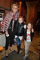 NADJA SWAROVSKI and her daughters left THALIA ADAMS and right JASMINE ADAMS at a performance of Karen Ruimy's show ZIK'R held at the Union Chapel, Islington, London on 21st November 2014.