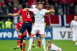Mohammed Abdellaoue of Norway vs Bostjan Cesar of Slovenia during the FIFA World Cup 2014 Group E qualification match between Slovenia and Norway on October 11, 2013 in Stadium Ljudski vrt, Maribor, Slovenia. (Photo by Urban Urbanc / Sportida)