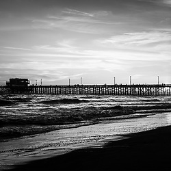 Newport Beach Pier black and white picture. Newport Pier is located on Balboa Peninsula and is a popular attraction along the Pacific Ocean in Orange County Southern California. Image Copyright © 2012 Paul Velgos with All Rights Reserved.
