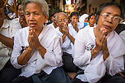 """04 FEBRUARY 2013 - PHNOM PENH, CAMBODIA:  Cambodians sit in the shade near the National Museum during the cremation service of King-Father Norodom Sihanouk in Phnom Penh. Norodom Sihanouk (31 October 1922- 15 October 2012) was the King of Cambodia from 1941 to 1955 and again from 1993 to 2004. He was the effective ruler of Cambodia from 1953 to 1970. After his second abdication in 2004, he was given the honorific of """"The King-Father of Cambodia."""" Sihanouk died in Beijing, China, where he was receiving medical care, on Oct. 15, 2012.   PHOTO BY JACK KURTZ"""