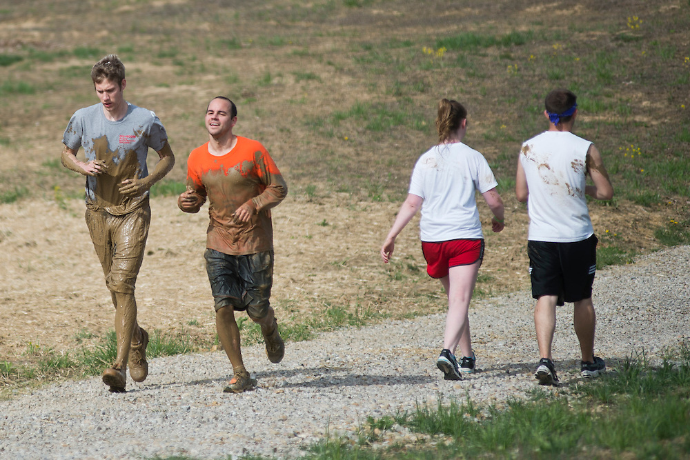 Participants run up and down the hill during the O'Bleness Race for a Reason Mud Run to complete and after completing the old Army ROTC training course located at the Ridges, Saturday, April 27, 2013. The course included a four-mile run up to the old Army ROTC Course at the Ridges, through the Radar Hill Trail and back to Tail Great Park across from Peden Stadium. Race for a Reason, Race 4 A Reason, Annual Events, Events, Students, Faculty & Staff