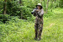 Becky Look dressed in camouflage with camera