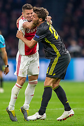 10-04-2019 NED: Champions League AFC Ajax - Juventus,  Amsterdam<br /> Round of 8, 1st leg / Ajax plays the first match 1-1 against Juventus during the UEFA Champions League first leg quarter-final football match / Battle between Dusan Tadic #10 of Ajax, Daniele Rugani #24 of Juventus