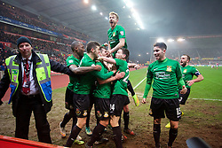 STOKE-ON-TRENT, ENGLAND - Sunday, January 4, 2015: Wrexham players mob goal-scorer Mark Carrington during the FA Cup 3rd Round match against Stoke City at the Britannia Stadium. (Pic by David Rawcliffe/Propaganda)