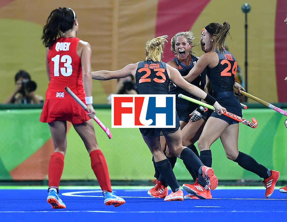 Netherlands' Kitty van Male (2nd R) celebrates after scoring a goal during the women's Gold medal hockey Netherlands vs Britain match of the Rio 2016 Olympics Games at the Olympic Hockey Centre in Rio de Janeiro on August 19, 2016. / AFP / MANAN VATSYAYANA        (Photo credit should read MANAN VATSYAYANA/AFP/Getty Images)