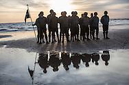 Reenactors honor guard on Omaha Beach