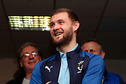 AFC Wimbledon attacker Shane McLoughlin (19) smiling at man of the match presentation during the EFL Sky Bet League 1 match between AFC Wimbledon and Fleetwood Town at the Cherry Red Records Stadium, Kingston, England on 8 February 2020.