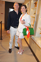 CAMILLA RUTHERFORD and DOMINIC BURNS at a party to launch the Godiva Chocolate Cafe at Harrods, London held on 24th May 2012.