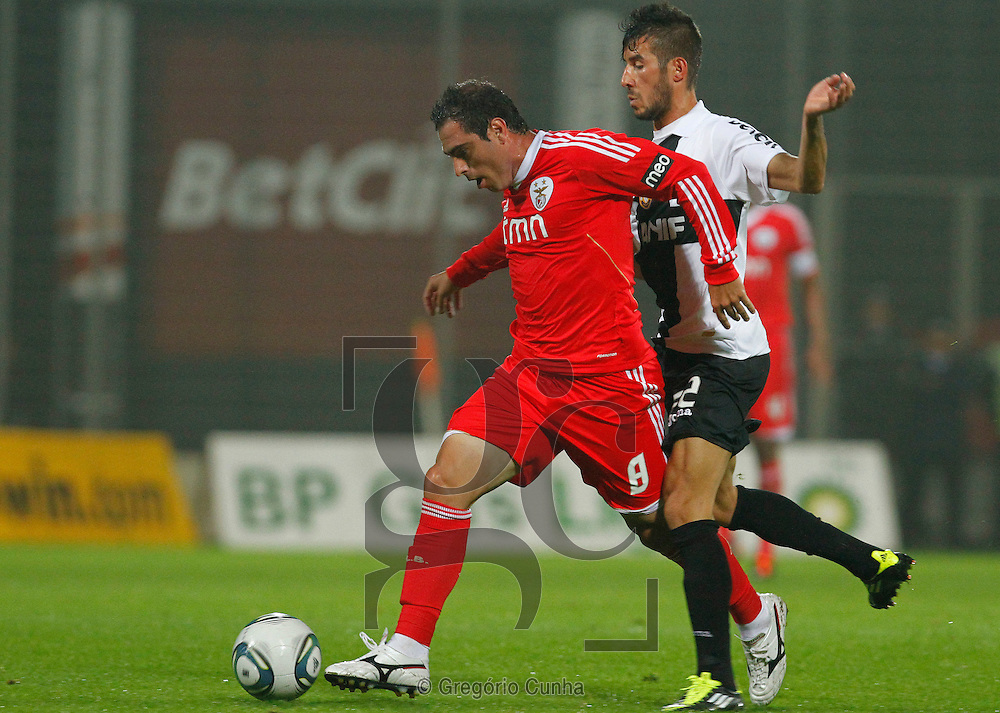 Portugal, Funchal, Madeira : Benfica's midfielder Bruno Cesar (L) vies with Nacional's forward Joao Aurelio (R) during the Portuguese league football match Nacional Madeira vs Benfica on August 29, 2011 at the Madeira Stadium in Funchal..PHOTO / GREGORIO CUNHA