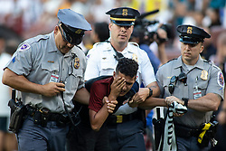 Place officers carry a fan off the field after the fan ran on the field during the International Champions Cup match between Juventus and Real Madrid at FedEx Field on August 4, 2018 in Landover, Maryland.