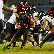 24 November 2018: San Diego State Aztecs running back Juwan Washington (29) rushes the ball for a short gain with time about to expire in the fourth quarter. The Aztecs closed out the season with a 31-30 overtime loss to Hawaii at SDCCU Stadium.