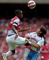 Photo: Daniel Hambury.<br />Arsenal v Aston Villa. The Barclays Premiership. 19/08/2006.<br />Arsenal's Johan Djourou and Villa's Juan Pablo Angel battle.