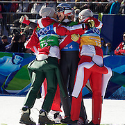 Winter Olympics, Vancouver, 2010.Austrian jumper Gregor Schlierenzauer is congratulated by team mates Wolfgang Loitzl, Andreas Kofler and Thomas Morgenstern after his final jump clinched the Gold Medal for Austria during the Ski Jumping Team final event at Whistler Olympic Park , Whistler, during the Vancouver Winter Olympics. 22nd February 2010. Photo Tim Clayton