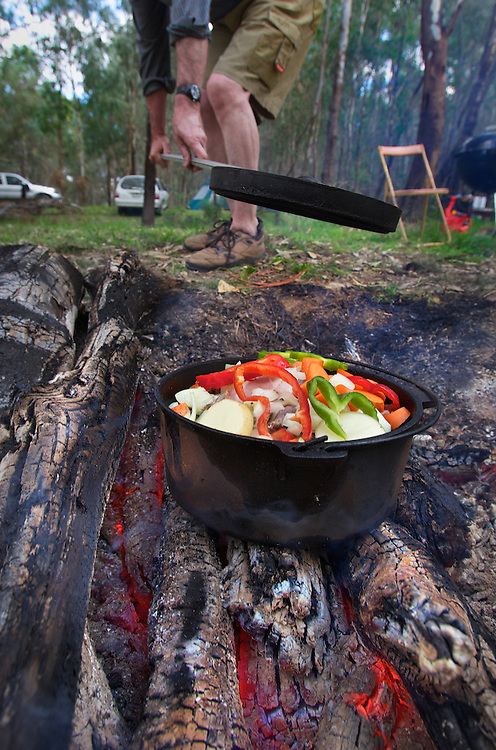 Collin Wood cooking duck on the camp fire. Duck hunting season openning weekend on the Murray River near Howlong. Pic By Craig Sillitoe CSZ/The Sunday Age 22/3/2011 melbourne photographers, commercial photographers, industrial photographers, corporate photographer, architectural photographers, This photograph can be used for non commercial uses with attribution. Credit: Craig Sillitoe Photography / http://www.csillitoe.com<br />