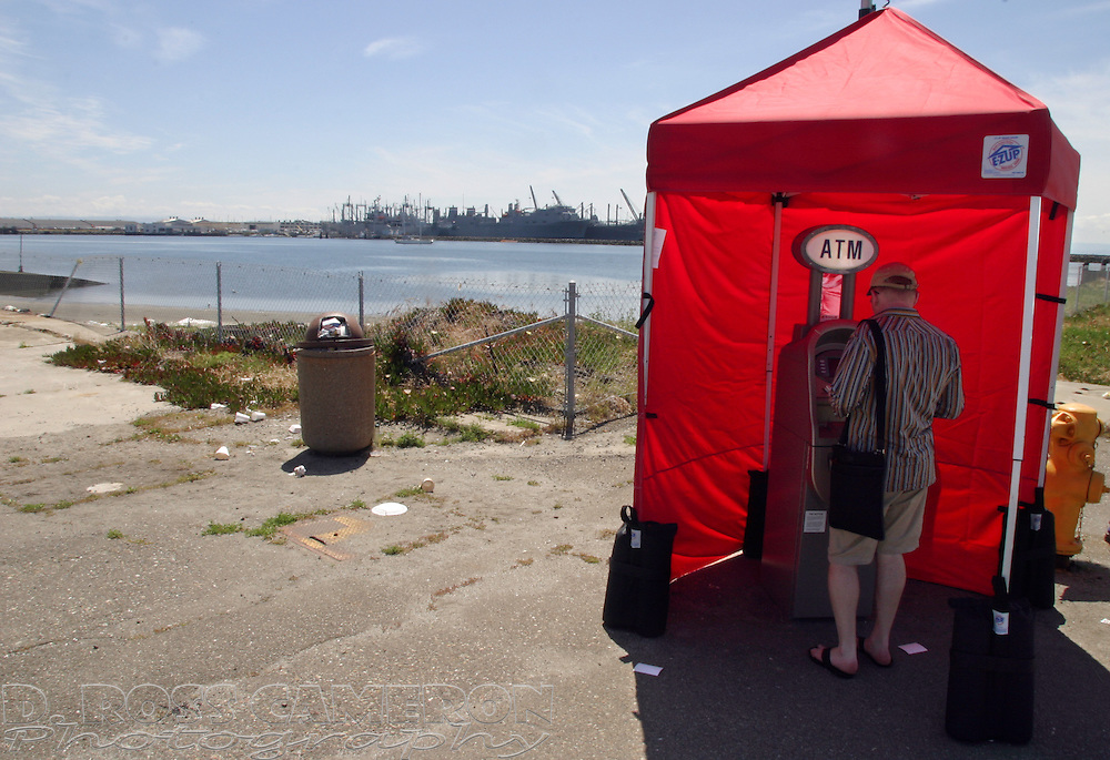 An ATM sits at the edge of the parking lot where the once-a-month antique fair is staged at the former Naval Air Station in Alameda, Calif., Sunday, May 1, 2005. (Photo by D. Ross Cameron)