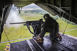 August 21, 2017 - Japan - A Marine Corps crew chief fires an M2 .50-caliber machine gun from the back of a CH-53E Super Stallion helicopter near Misawa Air Base, Japan, during exercise Northern Viper 17. (Credit Image: ? Andy Martinez/Marine Corps via ZUMA Wire/ZUMAPRESS.com)