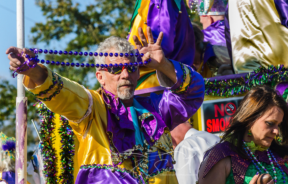 A member of the Cain Raiser Society taunts parade goers with a string of beads as his float travels down Washington Street in downtown Mobile, Ala., during the Joe Cain Procession at Mardi Gras, March 2, 2014.  French settlers held the first Mardi Gras in 1703, making Mobile's celebration the oldest Mardi Gras in the United States. (Photo by Carmen K. Sisson/Cloudybright)