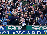 Photo. Glyn Thomas.<br /> Newcastle United v Wolverhampton Wanderers. <br /> FA Barclaycard Premiership. 09/05/2004.<br /> Newcastle's Lee Bowyer is mobbed by the fans after scoring his side's first half goal.