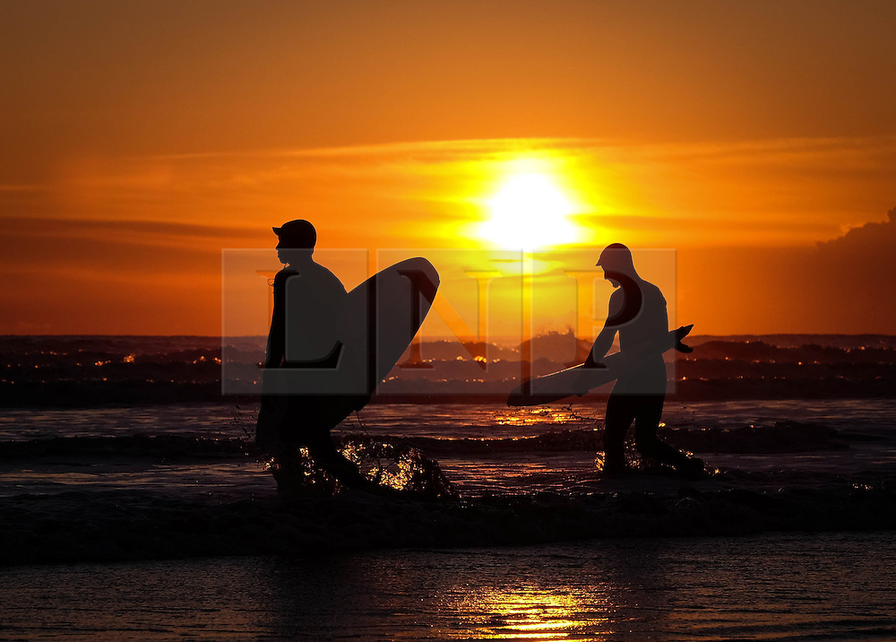 © Licensed to London News Pictures. 28/04/2016. SALTBURN BY THE SEA, UK.  <br /> Surfers KRIS FAIREST and JOSH KIDD head out for a dawn surf as the sunrises over the beach at Saltburn by the Sea.  Photo credit: Ian Forsyth/LNP