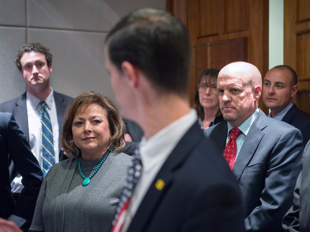 em031817d/a/Gov. Susana Martinez, left, and Rep. Tim Lewis, R-Rio Rancho, right, listen as Rep. Jason Harper, R-Rio Rancho, talks about his tax reform bill that died in the Senate. This was during a news conference after the legislature adjourned at the Roundhouse in Santa Fe, Saturday March 18, 2017. (Eddie Moore/Albuquerque Journal
