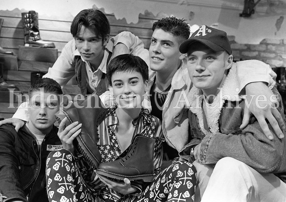 Pop group Boyzone were in Korky's Shoe Shop, Moore Street, Dublin, modelling Doc Martens boots. Pictured with Veronica Moore are Shane Lynch, Stephen Gately, Keith Duffy and Ronan Keating. 27/6/94. (Part of the Independent Newspapers Ireland/NLI Collection) (Part of the Independent Newspapers Ireland/NLI Collection)