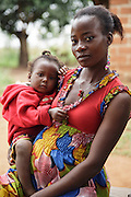 Rita Sahi, 25, who is 7-month pregnant with her third child, and her 2 year-old daughter Grace Stephanie Droh, at their home in Man, Cote d'Ivoire on Wednesday July 24, 2013.