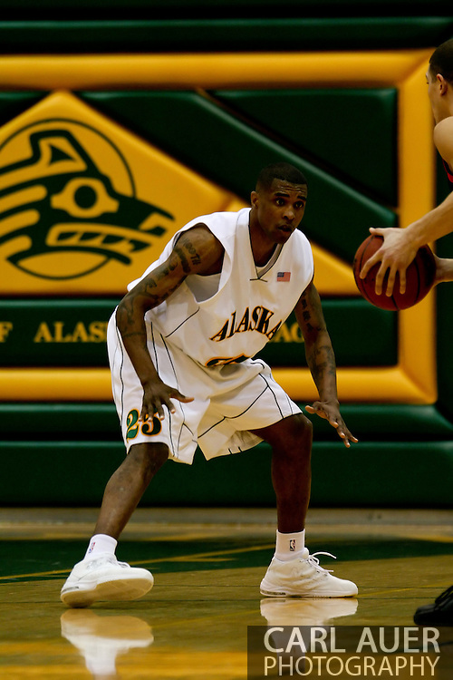 1/13/2006: Senior guard Eric Draper (25) of the UAA Seawolves defends the ball in the Alaska Anchorage comeback victory over Northwest Nazarene, 60-57, in men?s basketball action at the Wells Fargo Sports Complex on Saturday.